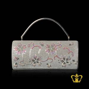 Shiny-white-shaded-ladies-purse-embellish-with-clear-and-black-crystal-stone-to-flower-design
