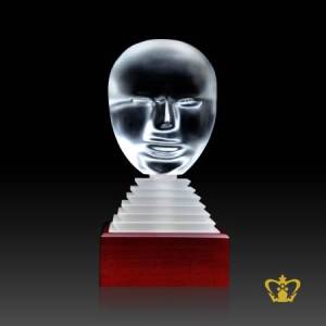 A-Masterpiece-Crystal-Replica-of-a-Twin-Face-stands-on-Crystal-and-Wooden-Base
