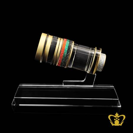 Masterpiece-crystal-replica-of-a-camera-lens-embellish-with-multicolor-crystal-diamond-stands-on-clear-base