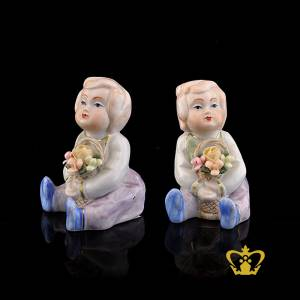 A-Masterpiece-Ceramic-Figurine-of-a-Baby-Doll-holding-a-Basket-with-Bouquet-of-Flowers