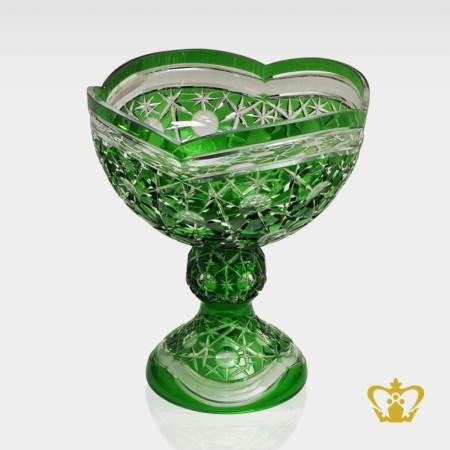 Tantalizing-green-footed-crystal-bowl-with-intense-gleaming-charming-pattern-hand-carved
